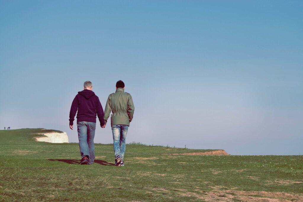 Men Holding Hands Walking